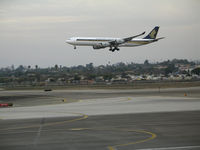 9V-SGC @ LAX - Singapore Airlines A340-541 on final approach to LAX - by Steve Nation