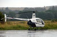 G-CTRL @ EGBN - Robinson R22 Beta at a wet Tollerton airfield