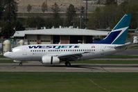 C-GWSJ @ CYLW - Westjet Boeing 737-600