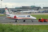 VP-CED @ EGCC - Cessna Citation - Under Tow - by David Burrell