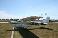 C-FBOE @ KOSH - Cessna 172 - by Mark Pasqualino