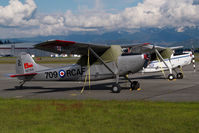 C-FTGF @ CYXX - Cessna 305 - by Yakfreak - VAP