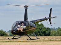 G-DMRA @ EGBO - Robinson R44 Raven II - by Robert Beaver