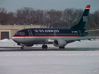 N334US @ PVD - Brrrr! Snow! N334US B737-300 with US Airways ready to depart PVD after a midwinter snowfall! - by Geoff Cook