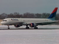 N641DL @ PVD - N641DL getting ready to head south to Atlanta from Providence after a midwinter snowfall - by Geoff Cook
