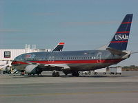 N776AU @ PVD - US Air's N776AU Boeing 737 parked at the gate in Providence RI 22nd Oct 2002 - by Geoff Cook