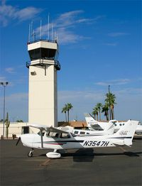 N3547H @ FFZ - Cessna Skyhawk, N3547H sits in front of the Mesa Falcon field tower after arriving from Glendale, Arizona