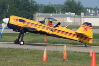 N131BW @ KOSH - Sukhoi SU-31 - by Mark Pasqualino