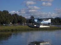 N1253Q @ LHD - Cessna A185F SKYWAGON, Continental IO-520-D 300 Hp, near splashdown - by Doug Robertson
