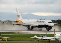 G-OZBK @ EGCC - Monarch wet arrival - by Kevin Murphy