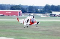 1459 @ DPA - HH-52A hovering for photo from control tower - by Glenn E. Chatfield