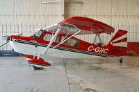 C-GIIC @ YXU - Parked inside the Executive Aviation hangar. - by topgun3