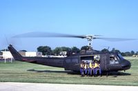 64-13885 @ DPA - UH-1H with Navy parachute team.  This Huey saw combat in Vietnam. - by Glenn E. Chatfield