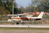 C-GZKT @ YKF - Landing on Runway 25 at Waterloo Airport, Ontario Canada - by Shawn Hathaway