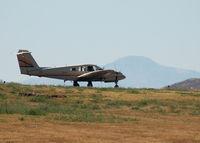 N103BM @ KAPA - Taxi to takeoff, Pike's Peak in the background. - by Bluedharma
