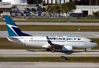 C-GWBN @ KFLL - Westjet B737 -One of the few daily 'foreign' visitors