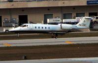 XA-TZI @ KFLL - Learjet 60