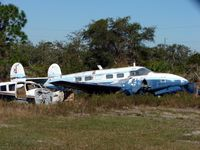 N136L @ X26 - Unable to get an angle that would show the registration serial of this wreck - by Terry Fletcher
