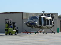 UNKNOWN @ GPM - Bell 205 type headed for a rebuild....I hope