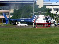 VH-SGK @ YBCS - Ambulance Helicopter adjacent to Hospital on Cairns Promenade