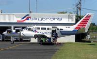 VH-SKV @ YBCS - Cessna 404