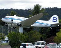 N5590C @ YBCS - unmarked Douglas DC3 on a pole at centre of Cairns Airport