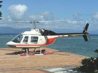 VH-JMN @ YBCS - Bell 206B landing tourists at Green Island , offshore from Cairns