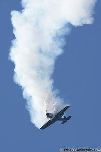 G-CBSS @ EBLE - Yak 52 flat spin. - by Eric Coeckelberghs