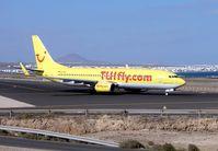 D-AHFI @ GCRR - A yellow TUI B737
