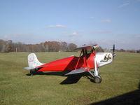 N12084 @ IA27 - Rhinehart-Rose Parakeet based at Antique Airfield near Blakesburg, IA - by BTBFlyboy