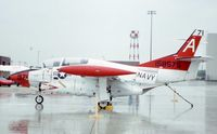 158575 @ ORD - T-2C at the AFR/ANG open house, in heavy rain - by Glenn E. Chatfield