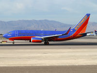 N448WN @ KLAS - Southwest Airlines - 'The Spirit of Kitty Hawk' / 2003 Boeing 737-7H4 - by Brad Campbell