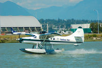 C-FITS @ CYVR - landing at the YVR seaplane facility. - by metricbolt