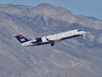 N7305V @ KLAS - US Airways Express / 1999 Bombardier Inc CL-600-2B19