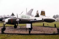 57-5922 @ GUS - U-3A at the Grissom AFB Museum, rainy day - by Glenn E. Chatfield