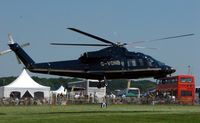 G-VONB - Helicopters arrive at the temporary Heliport on 2007 Epsom Derby Day (Horse racing) - by Terry Fletcher