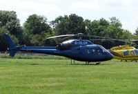 G-OLCP - Helicopters arrive at the temporary Heliport on 2007 Epsom Derby Day (Horse racing)