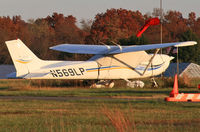 N569LP @ 47N - A new Cessna Skyhawk reflects the golden evening autumn sun. - by Daniel L. Berek