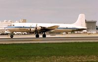 HI-592CT @ MIA - This DC6-B used to regularly operate for Aerochargo and Aeromar into Florida , but now lies derelict in the Dominican Republic . Interestingly originally registered as N6815C it worked as an Airborne TV Station , before being sold to LAN Chile