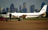 N41LH @ DAL - This photo is of the de-registered G159 in 2001 as it sits at Love Field against the backdrop of downtown Dallas - by Terry Fletcher
