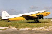 N220GB @ MTH - This DC3 sprayer was part of the Florida Mosquito Control when photographed at Marathon FL in 1991