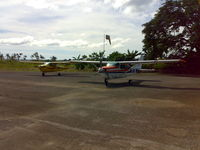 6Y-JTC @ MKNG - Picture of Tara Courier Services Ltd aircraft - # 6Y-JTC (Yellow Cessna on the left) Taken at Negril Aerodrome Jamaica - by Michael James