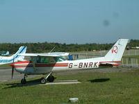 G-BNRK @ EGLK - Taken at Blackbushe Airport 8th September 2004 (sorry about the black spot on the lens) - by Steve Staunton