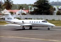 N972H @ TNCM - N972H was a Learjet 25 c/n 370 seen here at St.Maarten in 1993 . Subsequently became N888DV