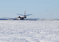 N284CP @ KAPA - Takeoff and full power. Look at the snow fly! - by Bluedharma