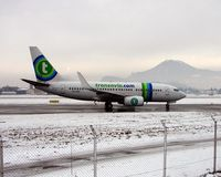 PH-XRZ @ LOWS - Transavia B737-700 taxies to the hold at Salzburg on a very icy morning