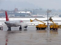 OE-LBQ @ LOWS - This Lauda A320 gets the de-icer treatment before its first rotation of the day from Salzburg