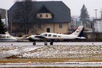 OE-FRD @ LOWS - Pa-34-220T taxies past the visitors on the GA ramp at Salzburg
