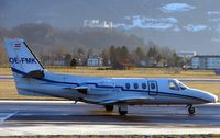 OE-FMK @ LOWS - Cessna 501 taxies out against the backdrop of the ancient Salzburg Fortress