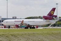 9M-TGQ @ WMSA - Transmile Air MD11 - by Andy Graf-VAP